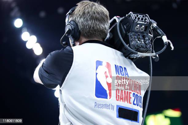The sponsor's logo on Cameraman vast is covered by the tape during a preseason game between the Brooklyn Nets and the Los Angeles Lakers as part of...