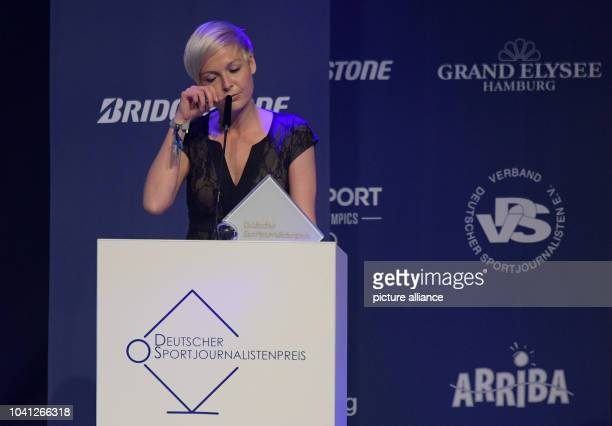 The sports journalist Anett Sattler stands on stage during the German Sports Journalist prize ceremony in Hamburg Germany 3 April 2017 Sattler is...
