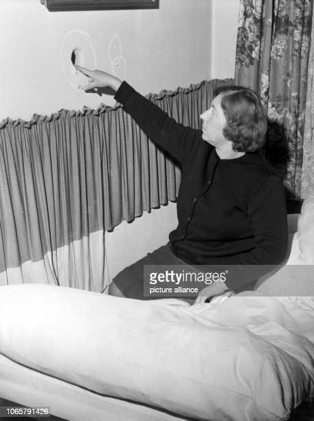The spot where the bullet striked into a wall over the woman's bed A man only suffered from slight lacerations during his escape to West Berlin on...