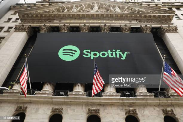 The Spotify banner hangs from the New York Stock Exchange on the morning that the music streaming service begins trading shares at the NYSE on April...