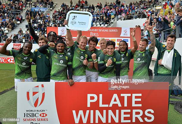 the Springbok 7's with the plate during the Plate final between South Africa and Australia on Day 3 of the HSBC Paris Sevens at Stade Jean Bouin on...