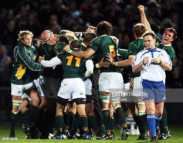 The Springboks celebrate their first ever win over the All Blacks at Carisbrook after the final whistle in the 2008 Tri Nations series match between...
