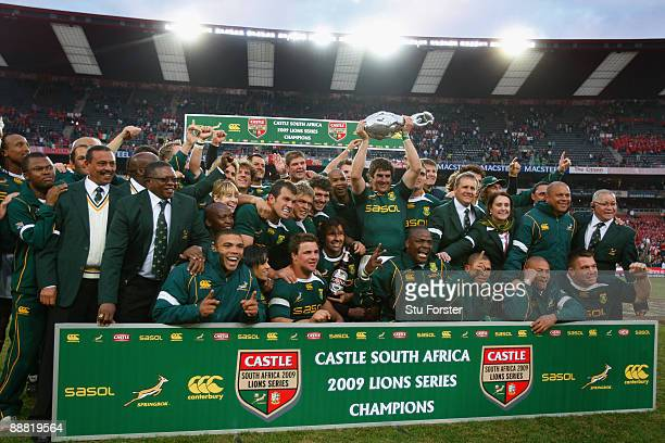 The Springboks celebrate with the series trophy after the Third Test match between South Africa and The British and Irish Lions at Ellis Park Stadium...