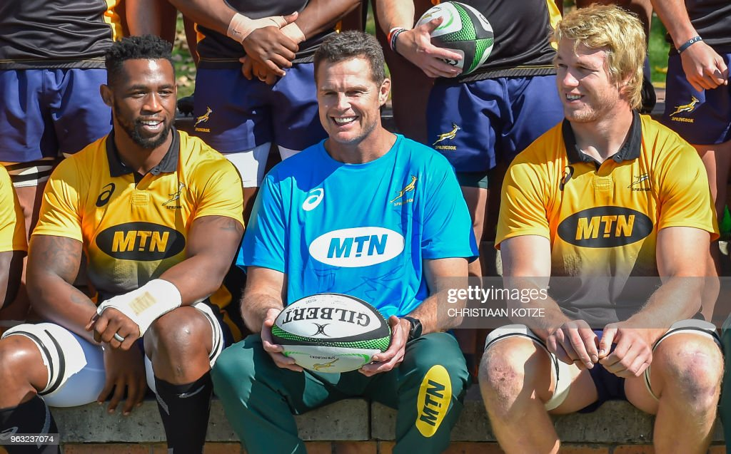 The Springboks' flanker Siya Kolisi, the first black Test captain who will lead South Africa in a three-Test series against England in June, new coach Rassie Erasmus and Pieter-Steph du Toit, who will lead South Africa in a one-off Test against Wales on June 2, pose during the first Springboks training session under the new couch Rassie Erasmus on May 28, 2018 at St Stithies College, in Johannesburg.