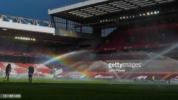The sprinklers create a rainbow during the Premier League match between Liverpool and Aston Villa at Anfield on April 10, 2021 in Liverpool, England....