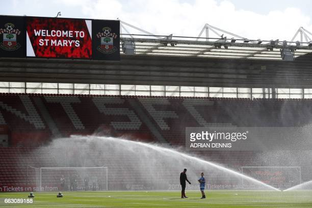 The sprinklers water the pitch ahead of the English Premier League football match between Southampton and Bournemouth at St Mary's Stadium in...