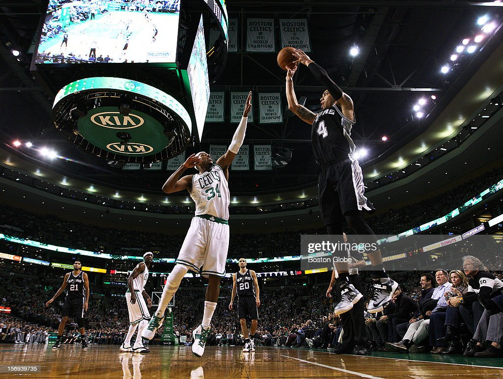 The Spurs Danny Green, right, gets off a first half three point attempt over the Celtics' Paul Pierce as the Boston Celtics hosted the San Antonio Spurs in a regular season NBA game at the TD Garden.