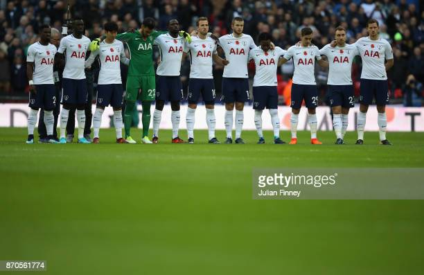 The Spurs team observe a minutes silence for rememberance day during the Premier League match between Tottenham Hotspur and Crystal Palace at Wembley...