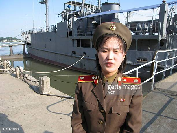 The spy ship USS Pueblo was seized by North Korea in 1968 and remains a trophy for the country A tour guide prepares to taken visitors aboard August...