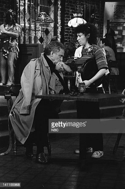 CHEERS 'The Spy Who Came in for a Cold One' Episode 12 Air Date Pictured Ellis Rabb as Eric Finch Rhea Perlman as Carla Tortelli Photo by Paul...