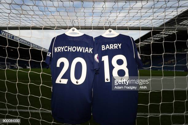 The squad numbers on the match shirts of Grzegorz Krychowiak of West Bromwich Albion and Gareth Barry of West Bromwich Albion represent the incoming...