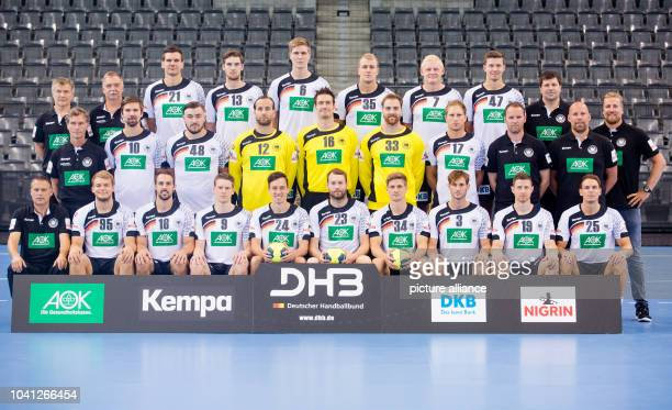 The squad of the German men's national handball team pose for a group photo Showing Team coordinator Volker Schurr Paul Drux Tim Kneule Tobias...