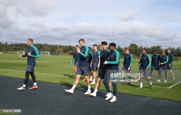 The squad walk out together onto the training pitch during the Tottenham Hotspur Training Session on October 2 2018 in Enfield England