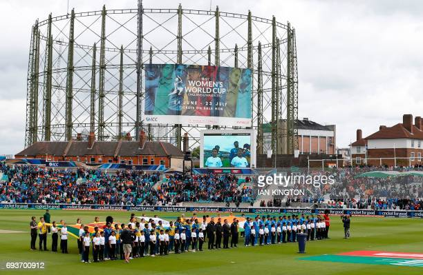 The Sri Lanka and India cricket teams sing their national anthems ahead of the ICC Champions Trophy match between India and Sri Lanka at The Oval in...