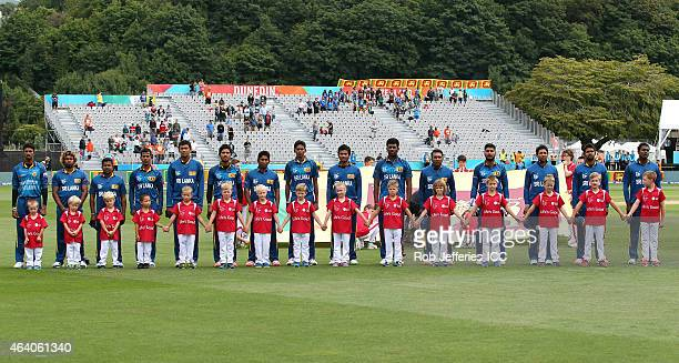 The Sri Lanka cricket team stand for their National Anthem during the 2015 ICC Cricket World Cup match between Sri Lanka and Afghanistan at...