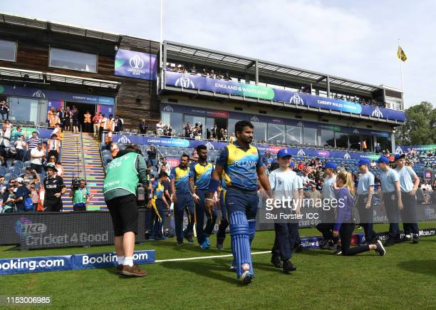 The Sri Lanka team make their way out with the mascots before the Group Stage match of the ICC Cricket World Cup 2019 between New Zealand at Cardiff...