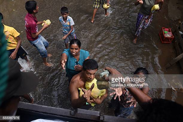 TOPSHOT The Sri Lankan army distributes food to flood victims in Kelaniya on the outskirts of Colombo on May 22 2016 Sri Lankan soldiers pulled more...