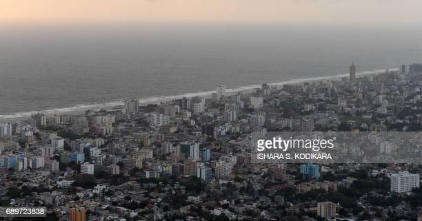 The Sri Lankan capital Colombo is seen from a Sri Lankan Air Force helicopter returning from floodhit districts on May 29 2017 Heavy monsoon rains in...
