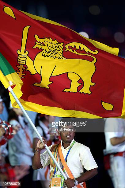 The Sri Lankan flag bearer looks on during the Opening Ceremony for the 16th Asian Games Guangzhou 2010 at Haixinsha Square on November 12 2010 in...