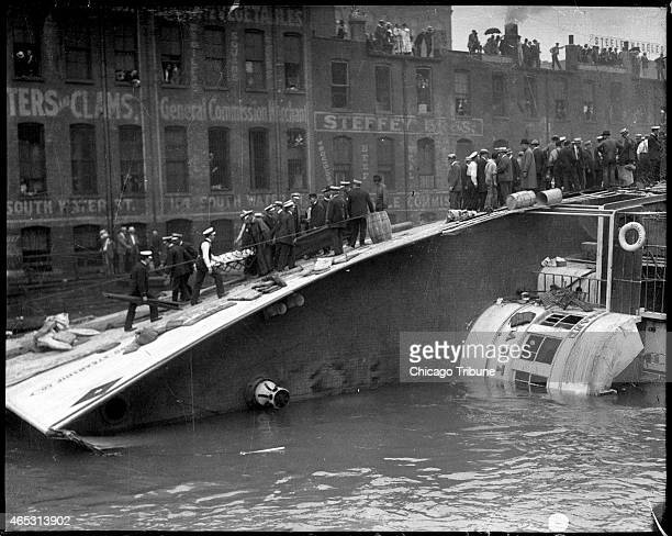 The S.S. Eastland lying on its side in the Chicago River after slowly rolling over and drowning 844 people on July 24, 1915.