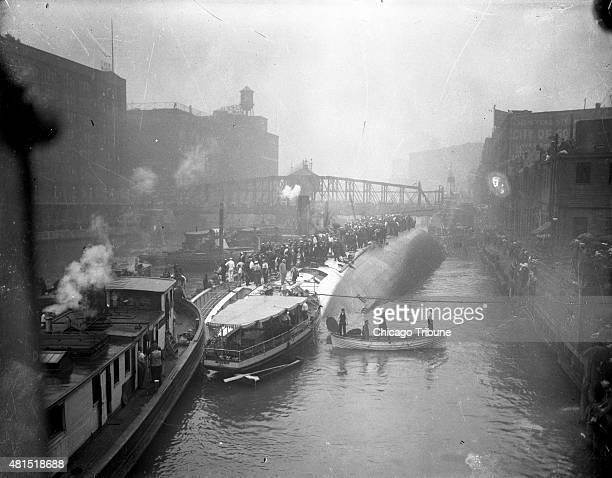 The S.S. Eastland lying on its side in the Chicago River after slowly rolling over and drowning 844 people on July 24, 1915 in Chicago.