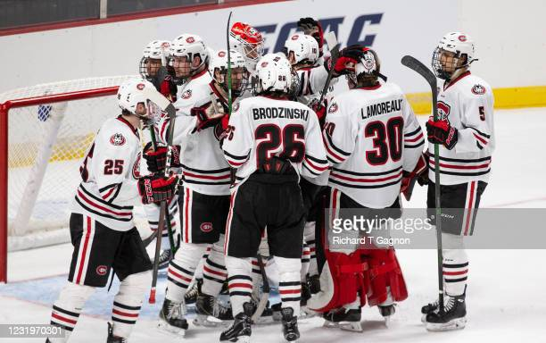 The St. Cloud State Huskies congratulate teammate David Hrenak after a game against the Boston University Terriers during the NCAA Men's Ice Hockey...