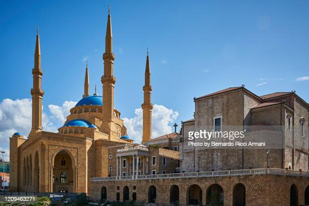 the st. george maronite cathedral close to the mohammad al-amin mosque - lebanon stock pictures, royalty-free photos & images