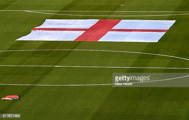 The St George's Cross flag is pictured on the pitch prior to the International Friendly match between Germany and England at Olympiastadion on March...