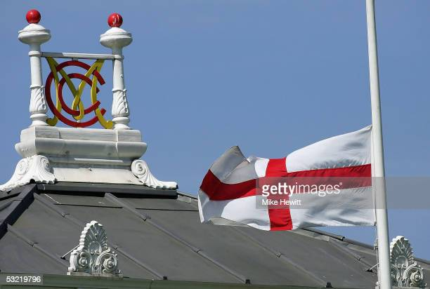 The St George's Flag flies at half mast as the England and Australian team stand for a minutes silence in front of The Pavilion for the London...