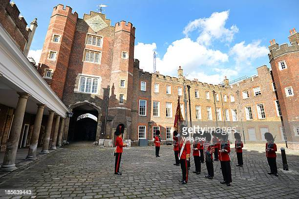 The St James's Palace detachment of The Queen's Guard turns out in Colour Court St James Palace for the arrival of Queen Elizabeth II ahead of the...