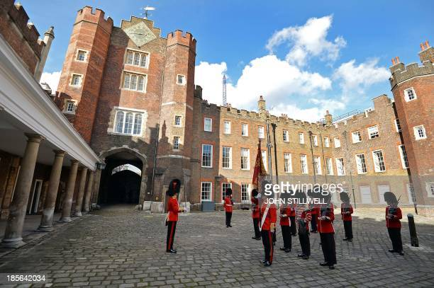 The St James's Palace detachment of The Queen's Guard turns out in Colour Court St James Palace for the arrival of Britain's Queen Elizabeth II ahead...
