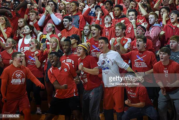 The St John's Cadet fans cheer after a free throw during the game between the St John's Cadets and the Gonzaga Eagles on Tuesday January 5 2016 The...