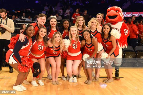 The St John's Red Storm cheerleaders pose before the quarterfinal round of the Big East Basketball Tournament against the Xavier Musketeers at the...