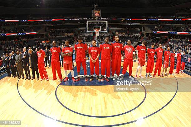 The St John's Red Storm line up for the National Anthem before a college basketball game against the Georgetown Hoyas at the Verizon Center on...