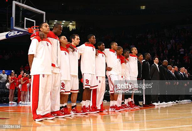 The St John's Red Storm players and coaches stand for the performance of the National anthem against the UCLA Bruins at Madison Square Garden on...