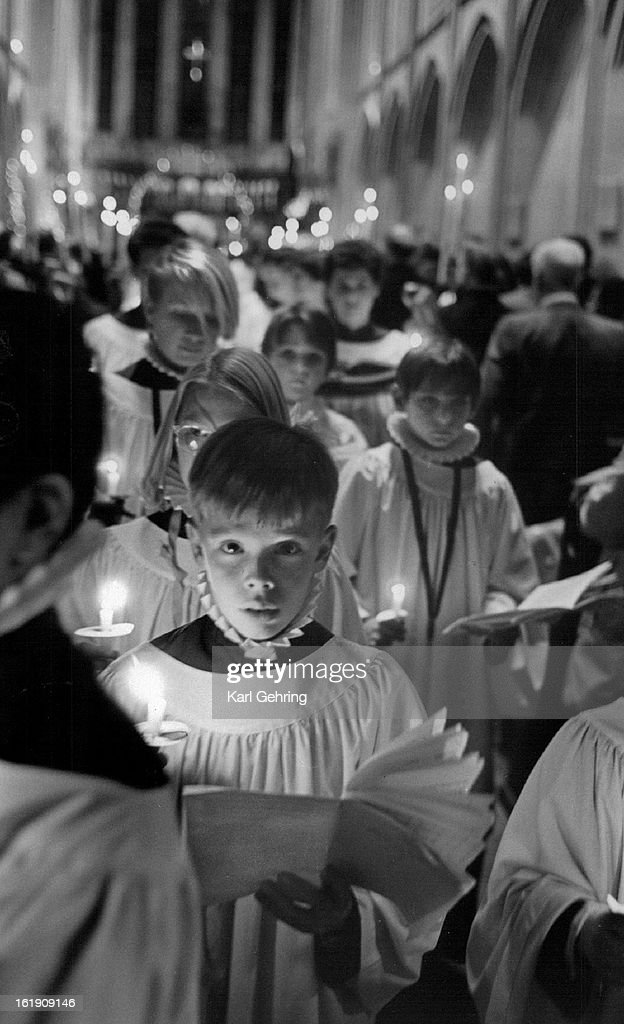 DEC 25 1986; The St. JohnT-(s Cathedral Boys and Girls' Choir exited the chapel holding candles after the first Christmas Eve service. The Cathedral is at 13th and Clarkson. Their was 3 services Wednesday night. Their is one Christmas Day service at 10 a.m. The Choir will sing carols from the gallery before the service.;