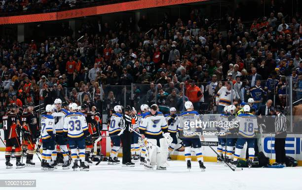 The St Louis Blues and the Anaheim Ducks watch as the paramedics tend to Jay Bouwmeester of the St Louis Blues after he collapsed on the bench during...
