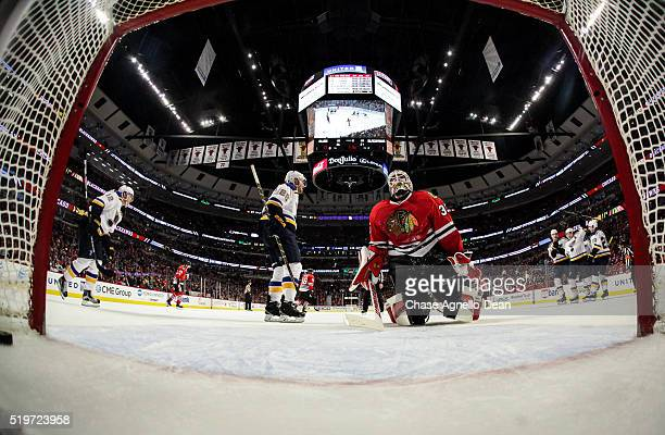 The St Louis Blues celebrate behind goalie Scott Darling of the Chicago Blackhawks after the Blues tied it in the third period of the NHL game at the...