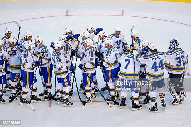 The St Louis Blues celebrate their win after the third period of a NHL Winter Classic Alumni hockey game between the Chicago Blackhawks and the St...