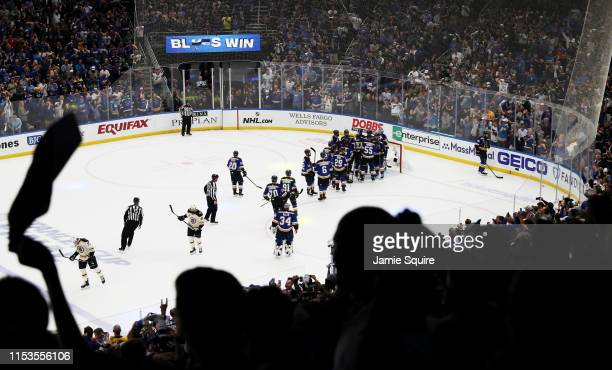 The St Louis Blues mob Jordan Binnington after defeating the Boston Bruins 42 in Game Four of the 2019 NHL Stanley Cup Final at Enterprise Center on...