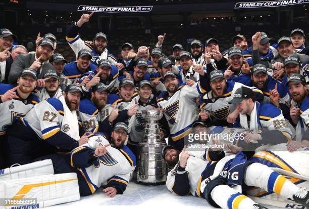 The St Louis Blues pose for a photo with the Stanley Cup on the ice after the 2019 NHL Stanley Cup Final at TD Garden on June 12 2019 in Boston...