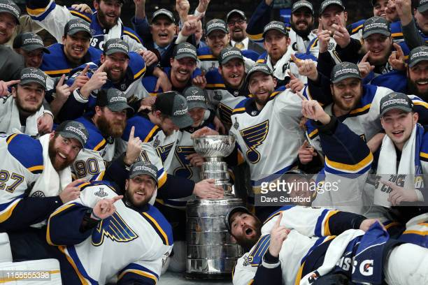 The St. Louis Blues pose for a photo with the Stanley Cup on the ice after the 2019 NHL Stanley Cup Final at TD Garden on June 12, 2019 in Boston,...