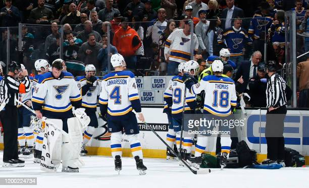 The St Louis Blues watch as the paramedics tend to Jay Bouwmeester of the St Louis Blues after he collapsed on the bench during the first period of...