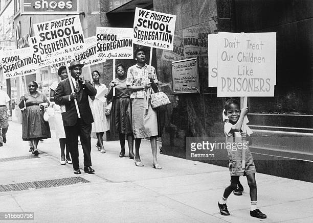 The St Louis Board of Education was picketed by the NAACP after the Board issued a modified enrollment plan which the NAACP did not go far enough in...