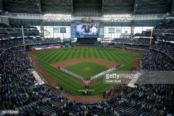 The St Louis Cardinals and Milwaukee Brewers stand for the singing of the national anthem before the game at Miller Park on April 2 2018 in Milwaukee...
