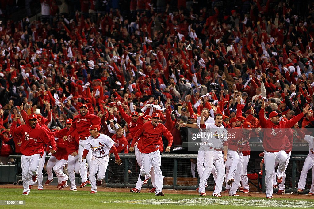 The St. Louis Cardinals bench runs on the field after David Freese #23 hits a walk off solo home run in the 11th inning to win Game Six of the MLB World Series against the Texas Rangers at Busch Stadium on October 27, 2011 in St Louis, Missouri. The Cardinals won 10-9.