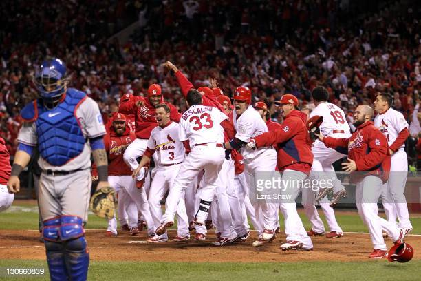 The St Louis Cardinals celebrate after David Freese hits a walk off solo home run in the 11th inning to win Game Six of the MLB World Series against...