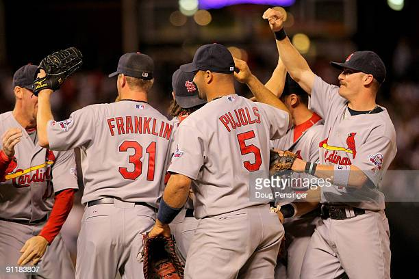 The St Louis Cardinals celebrate after defeating the Colorado Rockies and clinching the National League Central Division at Coors Field on September...