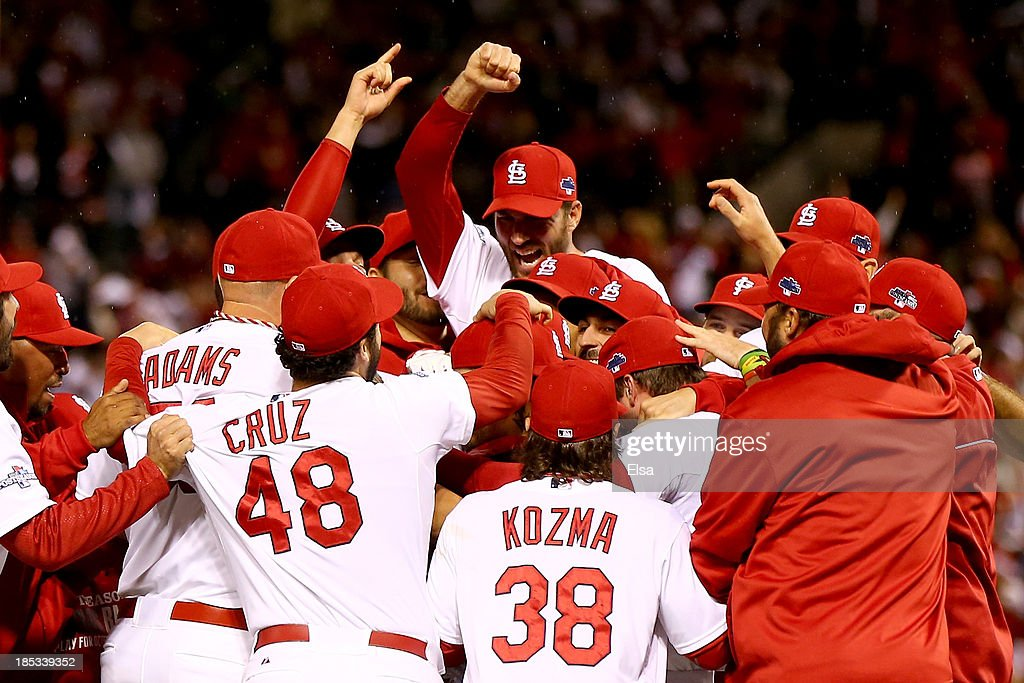 The St. Louis Cardinals celebrate after defeating the Los Angeles Dodgers 9-0 in Game Six of the National League Championship Series at Busch Stadium on October 18, 2013 in St Louis, Missouri.
