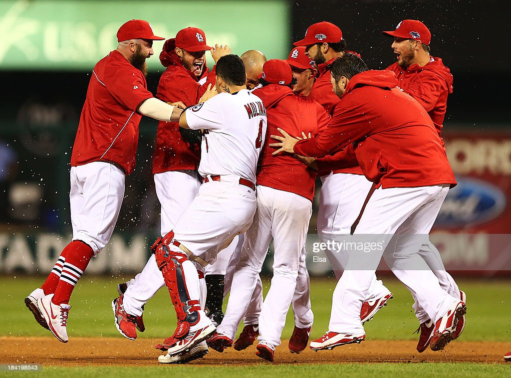 The St. Louis Cardinals celebrate defeating the Los Angeles Dodgers in Game One of the National League Championship Series at Busch Stadium on October 11, 2013 in St Louis, Missouri.